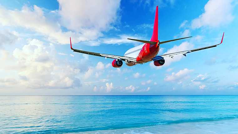 aerial; air; aircraft; airline; airplane; airway; arrivals; aviation; beach; beautiful; blue; caribbean; colorful; concept; destination; distance; ecology; environment; flight; flying; jet; journey; landscape; light; nature; ocean; orange; outdoor; plane; sand; scene; scenery; sea; shadow; shine; silhouette; sky; speed; sunlight; sunrise; sunset; technology; tourism; transport; transportation; travel; turquoise; vivid; water; wing;