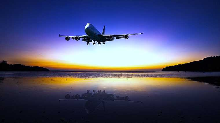 aircraft; airliner; airplane; airport; arrival; aviation; background; bay; beach; beautiful; beauty; blue; bright; charter; coastline; concept; dark; dramatic; dream; dusk; fantastic; flight; horizontal; jet; landing; landscape; large; morning; nature; night; ocean; orange; passenger; reflection; sea; seascape; silhouette; sky; sunlight; sunrise; sunset; tourism; touristic; transportation; travel; twilight; vacation; view; water; yellow;