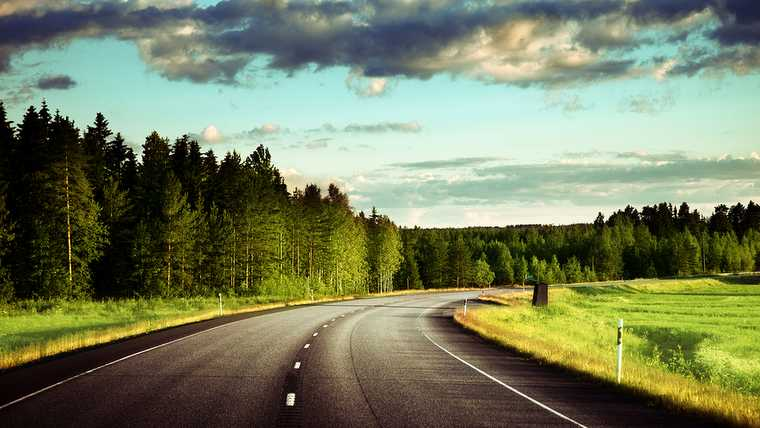 asphalt; blue; cloud; cloudy; country; countryside; dawn; day; destination; drive; empty; forest; freedom; freeway; grass; green; highway; horizon; journey; landscape; meadow; motion; nature; nobody; non-urban; outdoor; park; road; roadway; route; rural; scenery; sky; speed; speedway; summer; sun; sunny; sunrise; sunset; traffic; transport; transportation; travel; tree; trip; view; way;