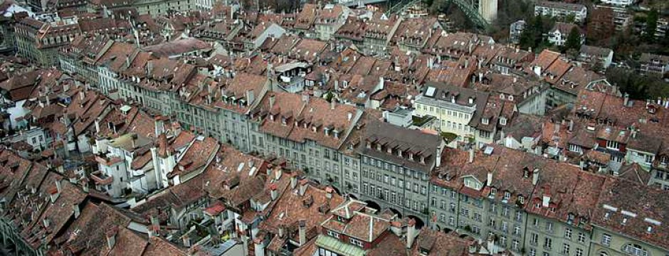 architecture; backgrounds; berne; bridge; buildings; built; cityscape; day; europe; horizontal; house; instrument; locations; musical; river; scene; structure; sunlight; switzerland; town; travel; urban;